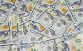 picture of one hundred dollar bill  - One hundred dollars pile as background - JPG