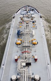 picture of barge  - View from a bridge down to an oil or gas tanker a barge on the Rhine river in Germany - JPG