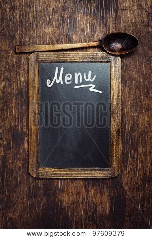 Wooden spoon and Blackboard