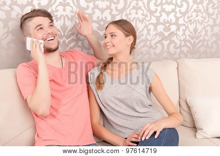 Merry husband holding mobile phone