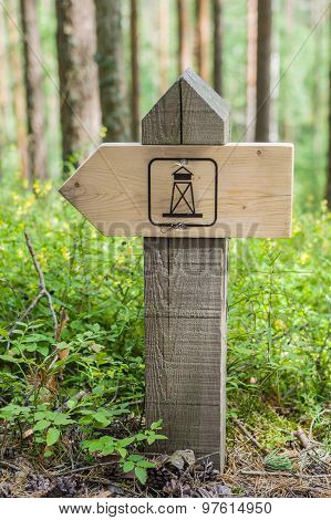 Wooden Hiking Trail Guidepost Of Landmark In The Forest
