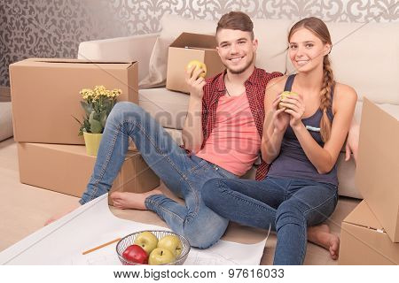 Pleasant young couple holding apples
