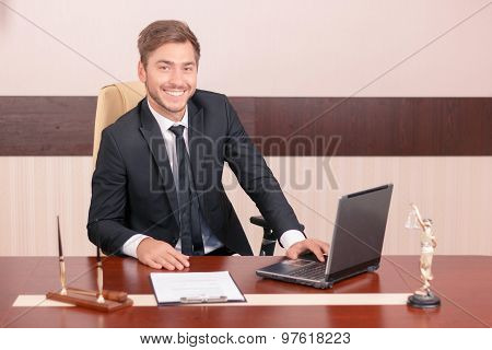 Vivacious lawyer sitting at the table