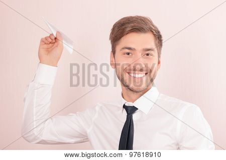 Pleasant lawyer holding paper plane