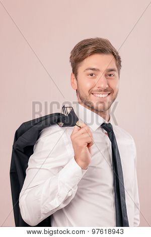 Upbeat lawyer holding jacket on shoulder