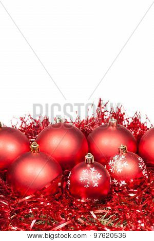 Several Red X-mas Baubles And Tinsel Isolated
