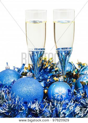 Glasses Of Champagne And Blue Xmas Ball And Tinsel