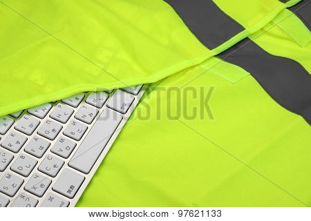 Keyboard In The Yellow Reflective Safety Vest