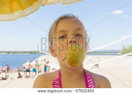 Cute Girl Biting An Apple