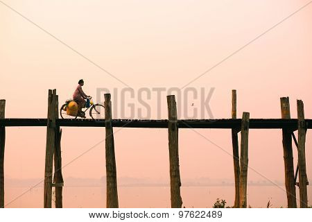 People walk on U-Bein bridge