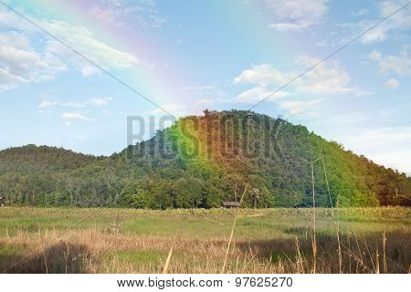 mountain view with rainbow from nature in thailand