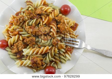 Colored Pasta With Meat And Cherry Tomato