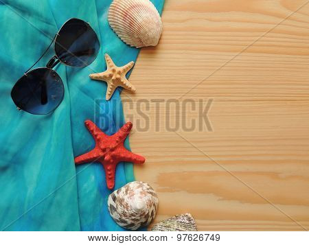 Summer sea composition on wooden background.