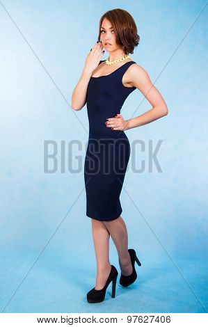 Beautiful Young Woman In A Short Blue Dress