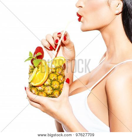 Woman Drink Tropical Cocktail In Pineapple With Straw Closeup