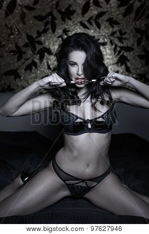 Sexy Woman In Underwear Kneeling On Bed With Handcuffs