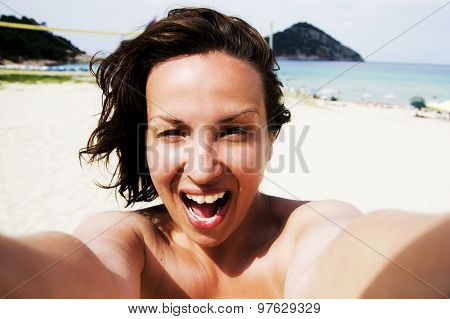 Woman Self Portrait On Beach