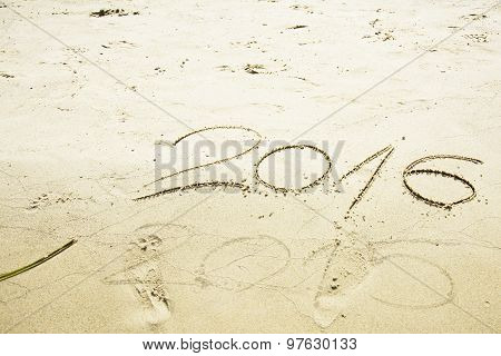 Numbers 2016 And 2015 Written In Sand