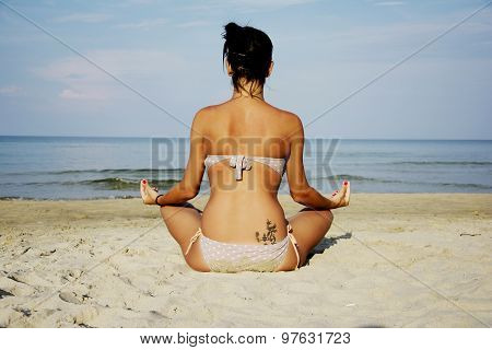 Woman On Beach Sitting Relaxed