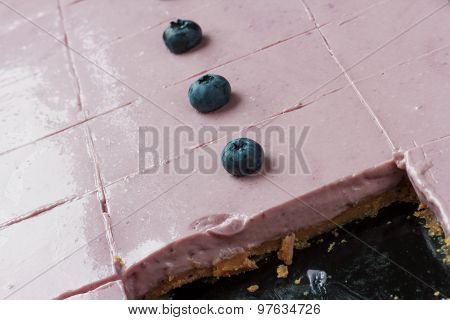 Blueberry cheesecake. Pink with blueberries on top.