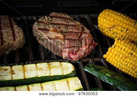 Rib Eye Steak With Zucchini And Corn On Grill, Soft Focus