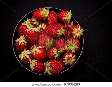 Ripe Fresh Strawberry In Bowl On Black