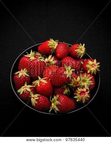 Ripe Fresh Strawberry In Bowl On Black Background
