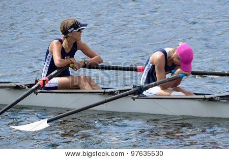 Exhausted lady scullers after finish of race.