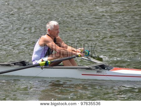 Older man in sculling competition on the river Ouse