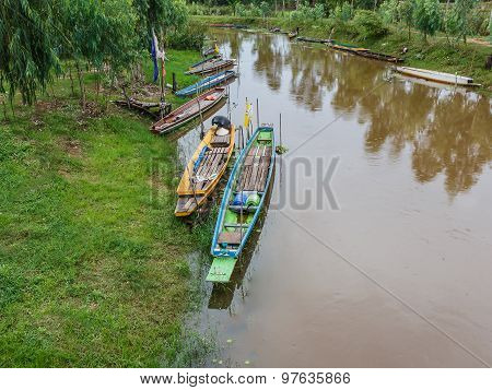 Wood Rowboat On Canal In Thailand