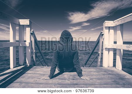 Alone Young Woman At The Edge Of Wooden Pier