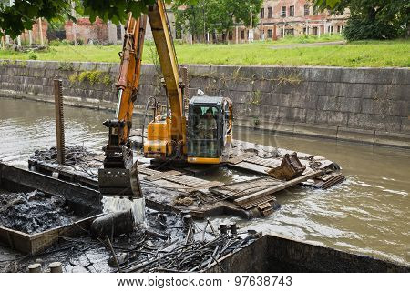 Working On The Dredger Clears The Bottom Of The Canal