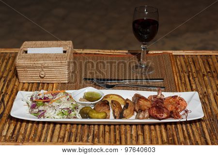 Seafood Mix Barbecue With Salad On Plate On Bamboo Table