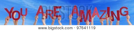 People Hands Holding Red Word You Are Amazing Blue Sky