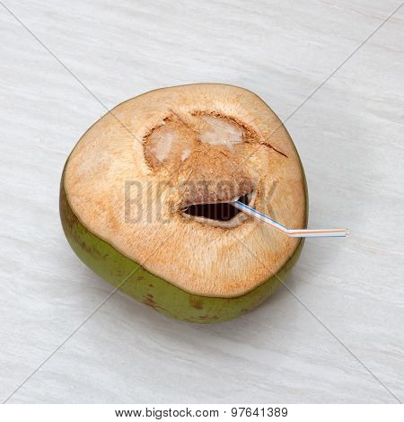 Fresh Green Young Coconut With Cut Out Smile And Straw On Wooden Background