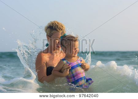 Mother And Daughter Swimming Together