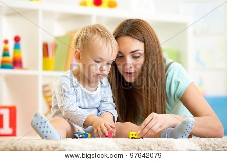 mom with her kid son play together