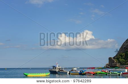 Multicolored Recreational Boats At Beach Berth In Novyi Svet Crimea.