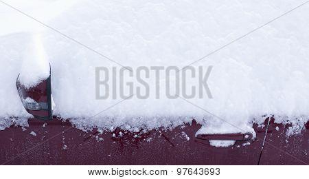 Rearview mirror, door, car locks and snow.