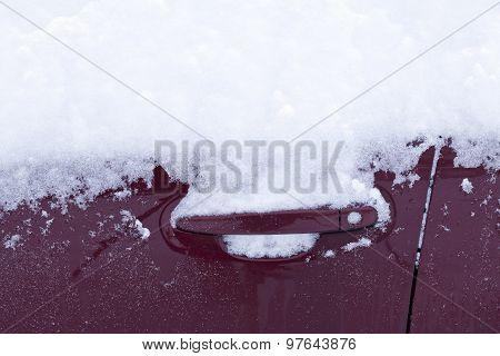 Car door, car locks and snow.