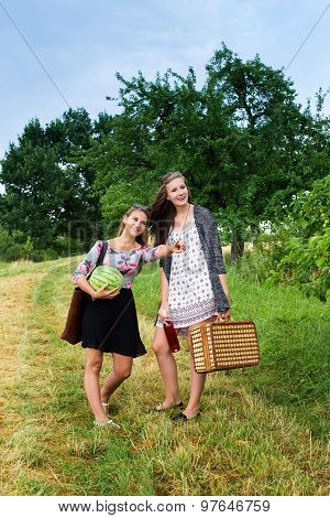 Two girls getting ready for a picnic