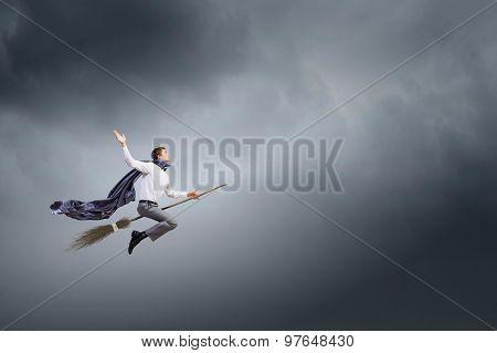 Man ride broom