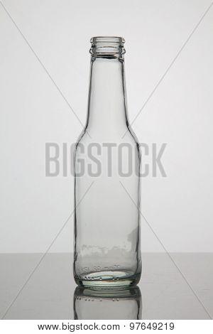 Empty bottle on white background