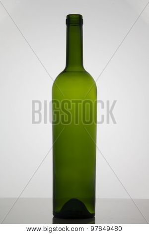 Empty bottle of wine on white background