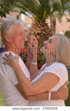 Senior couple dancing  on vacation