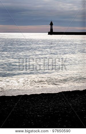 Silhouette Of A Lighthouse In The Sea