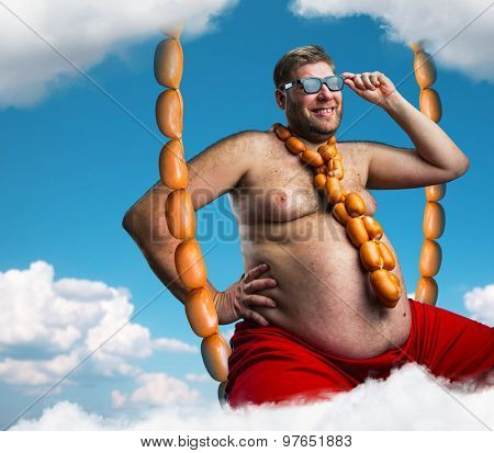 Happy man with sausages