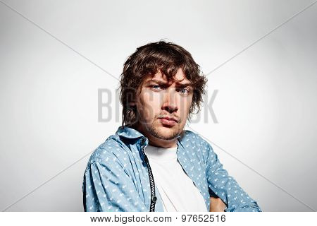 Closeup Portrait Distrust Young Man, Guy, Mad Worker At Isolated Grey Background. Negative Emotions,