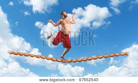 Man running on the sausage rope