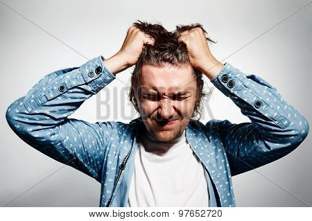 Closeup Headshot Very Sad Depressed, Stressed Disappointed Gloomy Young Man Head On Hands Screaming